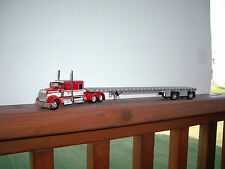 DCP 1/64 RED AND WHITE W900 KENWORTH WITH 60'' SLEEPER AND SPREAD AXLE FLAT BED