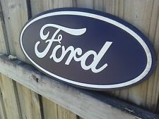 FORD OVAL LARGE EMBOSSED METAL SIGN WITH RAISED LETTERS 20 BY 9 INCHES FORD PART
