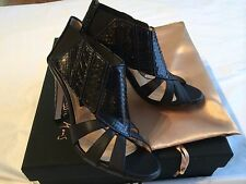 NIB**Chrissie Morris***Black Stingray Sandal Heels***EU 36 1/2;US 6 1/2**$1285