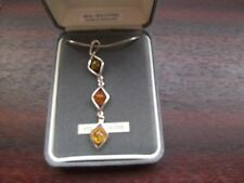 a 24 inches 3 stone silver amber necklace green orange and yellow amber