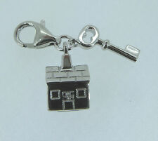 Sterling silver clip on cubic zirconia house and key charm