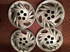 4 New Plymoth Neon Hubcaps Never Been Used from Hubcaps.com