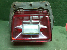1969 Ford Galaxie 500 LT tail light with housing. White light stressed chrome ok
