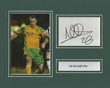 A 10 x 8 inch mounted display personally signed by Andy Hughes of Norwich City