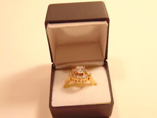 Pre-owned elegant gold colored fashion ring w/ large center cubic zirocon