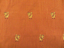 Embroidered rooster upholstery decorator material in rust red, gold and black