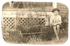 VINTAGE PHOTO PRE TEEN BOY w HAT RIDES in CART HARNASSED to his DOG 1915 RPPC