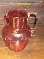 Cranberry glass pitcher with applied handle blown pontil