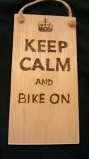 hand designed wooden plaque.keep calm and bike on.  Gift