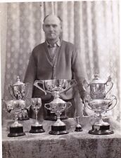 VINTAGE OLD PHOTO MAN SMOKING CIGARETTE BY TABLE OF SILVER CUPS TROPHIES 1950'S