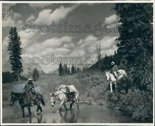 1938 Canadian Rocky Mountain Scene Men on Horses Cross Stream Press Photo