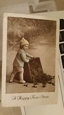 "Postcard Of "" New Year Card With Child Dumping Basket Of Good Luck Clover """