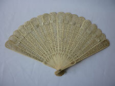 Ornately pierced vintage bone fan with cream ribbon
