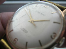 Gents vintage hallmarked  Baume 9ct gold watch .