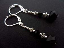 A PAIR OF BLACK CRYSTAL EARRINGS WITH LEVER BACK  HOOKS. NEW..