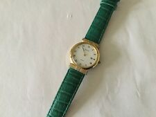 Pulsar Quartz Ladies Watch Green skin strap Plain white face with date