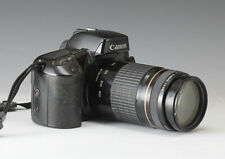 Canon EOS Elan 35MM Camera w/ Canon 75-300mm lens.