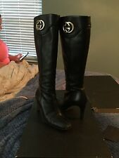 Gucci black leather tall heeled boots w/ goldtone GGon sides.  7 Fab!