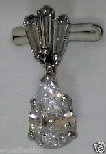 14 white gold pendant with pear and bagget c.z, Total weight 1.40 gram.