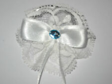 white lace childrens hair bobble with white ribbon bow and blue bead