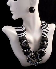 STYLISH NECKLACE IN ZEBRA PATTERN FABRIC BLACK CLEAR RINGS & AVON BLACK EARRINGS