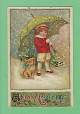 Cute LITTLE GIRL & DOG puppy under a GREEN & GOLD UMBRELLA in SNOW, X-mas TREE