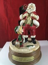"Christmas Musical Figurine- ""A Tight Fit '' by House of Lloyd"