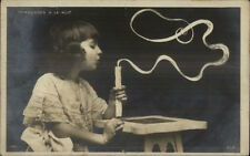 Trick Photography Effect Child Blowing Out Candle c1905 Real Photo Postcard