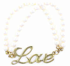 Gold coloured word love and pearl stretch bracelet