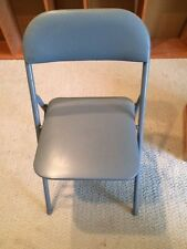 Folding chair, with metal frame, blue vinyl covered  padded seat and back.