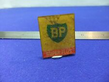 vtg badge bp petrol oil chequered flag flicker plastic badge 1960s