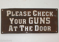 PLEASE CHECK YOUR GUNS AT THE DOOR - CAST IRON PLAQUE