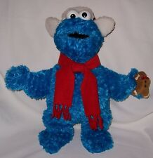 Cookie Monster dressed with Winter Hat & Red Scarf &  holding a Cookie