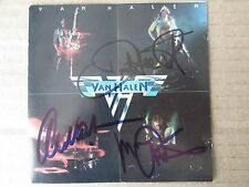 Van Halen  SIGNED 1st CD by David Lee Roth, Alex and Michael.