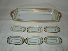 NORITAKE NIPPON HANDPAINTED GOLD APPLIED CELERY DISH AND FIVE SALTS DISHES