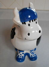 Black & White Cow with Blue Tennis Shoes and Helmet Cookie Jar