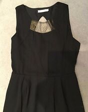 BLACK SLEEVELESS DRESS WITH GOLD NETTING ACROSS CHEST & GOLD BOW BEHIND-PLEATS-L