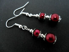 A PAIR OF DARK RED GLASS BEAD  SILVER  PLATED DANGLY EARRINGS.