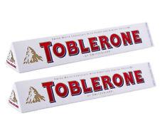 Lot de 2 toblerone de 360 grammes au chocolat blanc, produit livré neuf emballé.