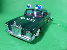 Ichiko Made in Japan - Mercedes Benz W111 Coupe Polizei Uhrwerk Version Tinplate