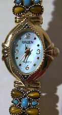GRUEN QUARTZ WATCH - TURQUOISE & BROWN COLORED STONES WITH BLUE FACE
