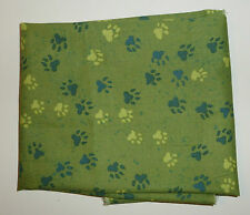 cotton poplin fat quarter in mottled light green with paw marks in green