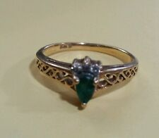 Natural pear-shaped .25ct. emerald and diamonds in a 10kt. gold setting