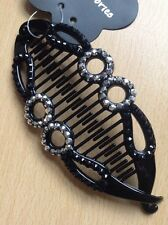 A Black And Silver Studded Banana/Fish Hair Clip