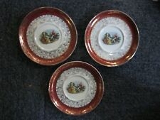 Sebring? Set of 3 Man Playing Flute and Woman Warranted 22K Gold Saucers Plates