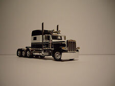 DCP 1/64 WHITE AND BLACK 4 AXLE 389 PETEBILT WITH 70'' MID-ROOF SLEEPER