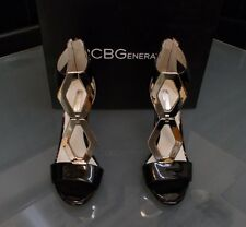 NEW IN BOX WOMENS SIZE 7 BLACK AND SILVER BCBG HIGH HEELS