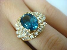 14K YELLOW GOLD 2 CARAT LONDON BLUE TOPAZ AND APPROX. 2 CT T.W. DIAMONDS RING