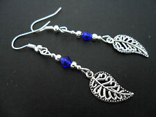 A PAIR OF TIBETAN SILVER & BLUE CRYSTAL DANGLY LEAF EARRINGS. NEW.