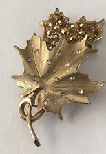 VINTAGE SARAH COVENTRY GOLD TONE AND RHINESTONE LEAF BROOCH